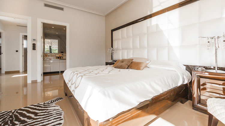 Brown Wooden Bed Frame with White Cover