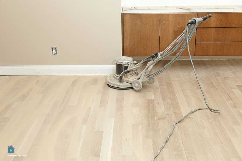 sanding hardwood floors with orbital sander