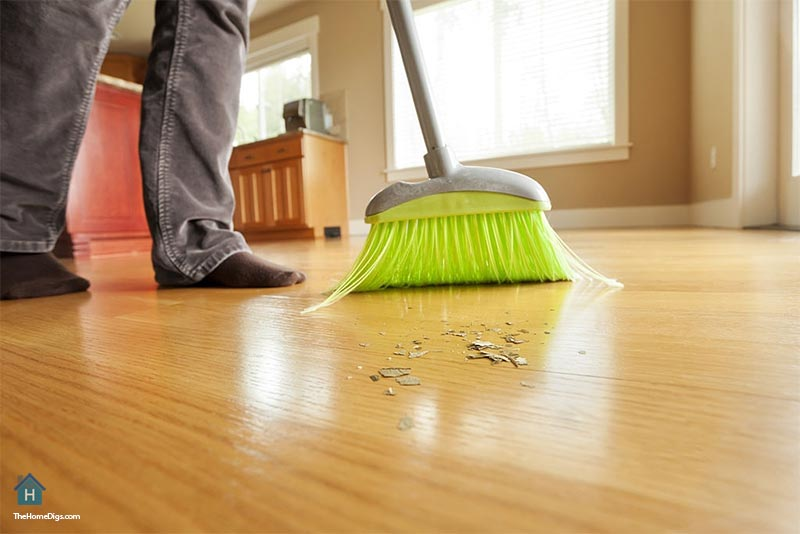 sweeping hardwood floors with soft bristle broom